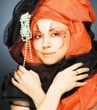 Young woman in black and orange turban Stock Photography