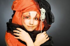 Young woman in black and orange turban Royalty Free Stock Photos