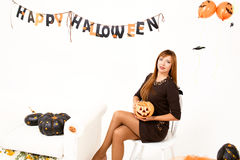 Young woman with black pumking Royalty Free Stock Images