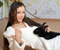 Young woman and black rabbit Royalty Free Stock Photos