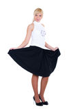 A young woman in black skirt Stock Image