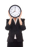 Young woman in black suit holding office clock Royalty Free Stock Photos