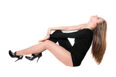 Young woman in a black tight-fitting body suit Royalty Free Stock Photography
