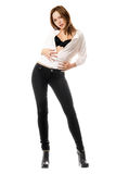 Young woman in black tight jeans Stock Photos
