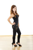 Young woman in black tight pants and high heels Stock Images