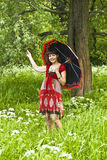 Young woman with black umbrella Royalty Free Stock Images