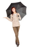Young woman with black umbrella Stock Image