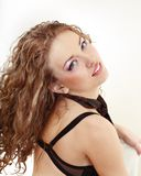 Young woman in black underwear looking up Stock Photography