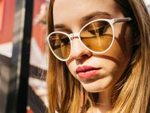Young woman in black wear and sunglasses outdoors stock images