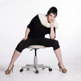 Young woman in black with white fur collar Royalty Free Stock Photo