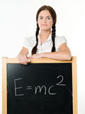 Young woman & blackboard. Education, classroom Royalty Free Stock Image