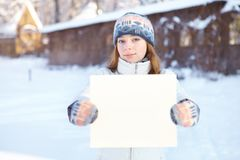 Young woman with blank banner outdoors. Winter. Stock Photography