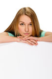 Young woman with blank billboard Royalty Free Stock Photography