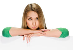 Young woman with blank billboard Stock Image