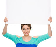 Young woman with blank billboard Stock Images