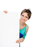Young woman with blank billboard Royalty Free Stock Images
