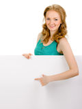 Young woman with blank billboard Stock Photos