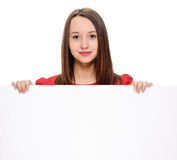 Young woman with blank billboard Stock Photography