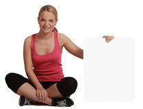 Young Woman with a Blank Board. A young woman  holding an empty white bill board against a white background Stock Photo