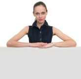 Young woman with blank board banner, isolated Royalty Free Stock Images