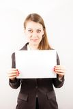 A young woman with a blank page Stock Photography