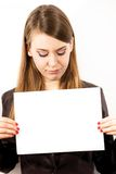 A young woman with a blank page. A young woman with a blank white page on a white background Stock Image