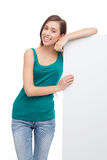 Young woman with blank poster Stock Images