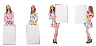 The young woman with blank poster isolated on white Stock Photos