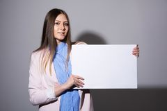 Young woman with blank sheet for advertising Stock Photo