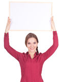 Young woman with a blank sign Royalty Free Stock Photos