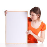 Young woman with a blank sign Royalty Free Stock Image