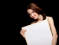 Young woman with a blank sign Stock Photos
