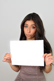 Young woman and blank sign. Royalty Free Stock Photography