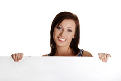 Young woman with blank white board. Royalty Free Stock Photography