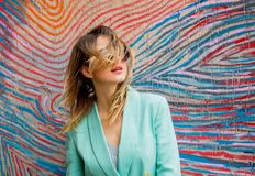 Young woman in Blazer of 90s style and sunglasses royalty free stock photography