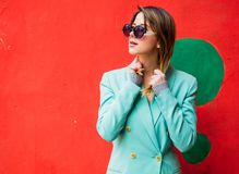Young woman in Blazert of 90s style and sunglasses stock photography