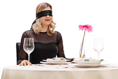 Young woman on a blind date stock image