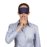 Young woman blindfolded calls for silence Royalty Free Stock Photography