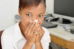 Young woman blocking the nostrils. This young woman has clogged her nostrils with her handkerchief because they flow Royalty Free Stock Image