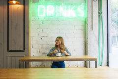 Young woman blogger on her coffee break Royalty Free Stock Image