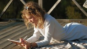 Woman is using a computer tablet outdoors. stock footage