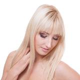 Young woman with blond hair Stock Photos