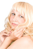 Young woman with blond hair. Closeup, isolated over white Royalty Free Stock Images