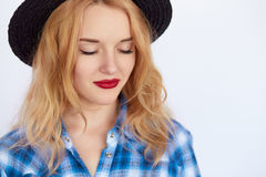 Young woman with blond hair keeping eyes closed. Hipster girl dreaming Royalty Free Stock Photos