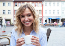 Young woman with blond hair loves coffee Stock Photography