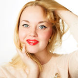 Young woman with blond hair and red lips Stock Images