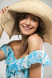 Young woman with blond hair in summer straw. Stock Photography
