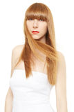 Young woman with blond, long, straight hair in wind Stock Images