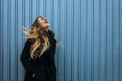 Young woman with blond straight long hairs in motion Royalty Free Stock Image