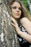 Young woman blonde on a background trees in a park Stock Photography